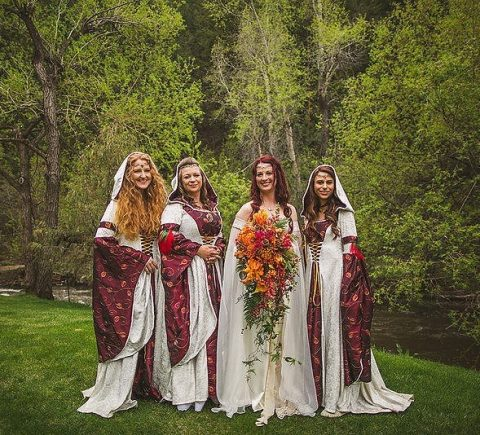 the bride and her bridesmaids dressed as elves