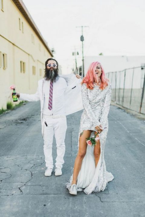 the couple wearing crazy outfits and white sneakers both to accent their cool looks