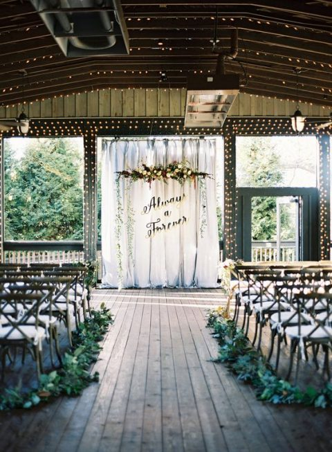 the wedding backdrop is inspired by Harry Potter quotes