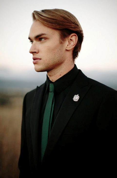 this groom look is inspired by Slytherin, done in black and green and with a proper boutonniere