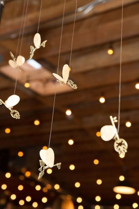 winged keys for wedding reception or ceremony space decor