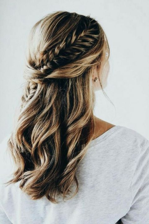 a boho chic wedding half updo with twists and a large French braid