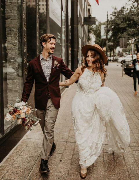 a boho groom outfit with grey pants, a printed shirt, a burgundy blazer and black boots
