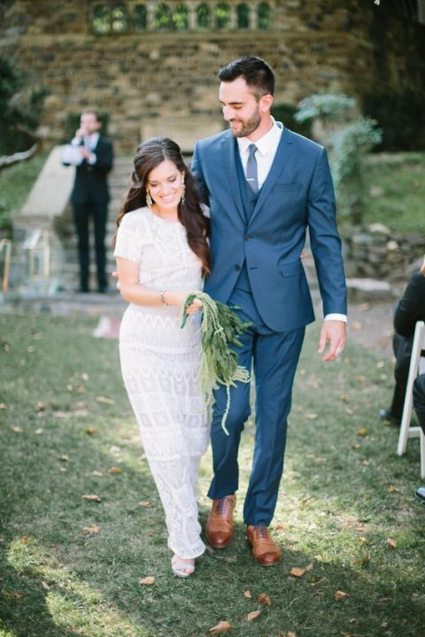 a boho lace sheath wedding dress with shirt sleeves and a high neckline