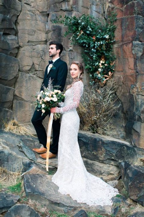 a boho lace wedding gown with long sleeves and a train looks very chic and girlish