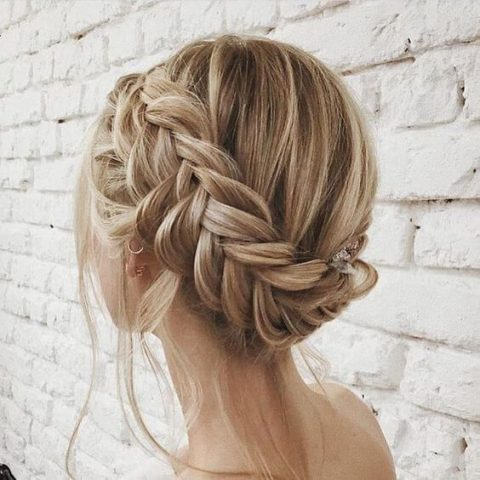 a braided updo with some locks down