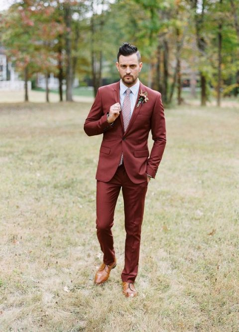a burgundy suit, a printed pink tie, brown shoes