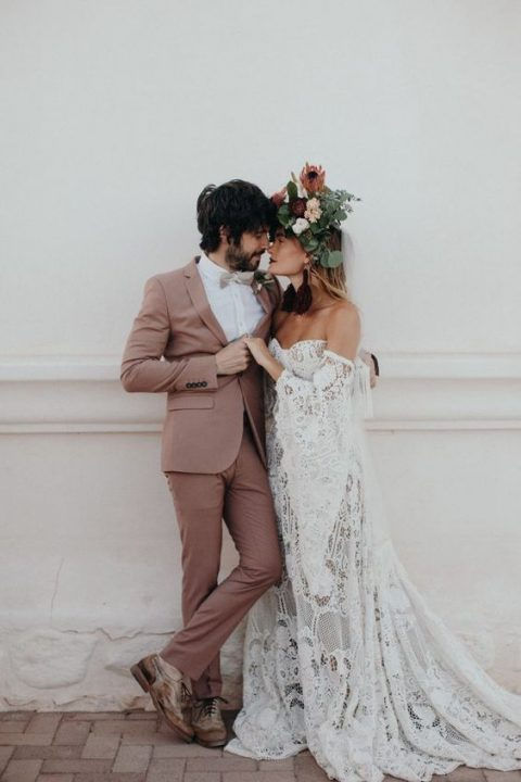 a chic mauve wedding suit, a white shirt, a creamy bow tie, shabby brown shoes