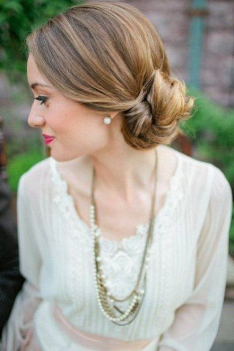 a chic twisted low side bun and a sleek top is a timelessly elegant hairstyle