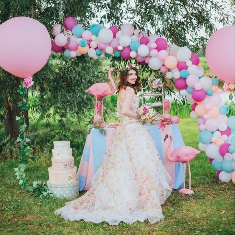 a colorful balloon arch over the dessert table for bold decor