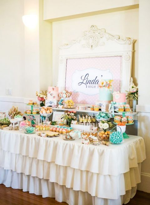 a colorful dessert table for a vintage high tea bridal shower