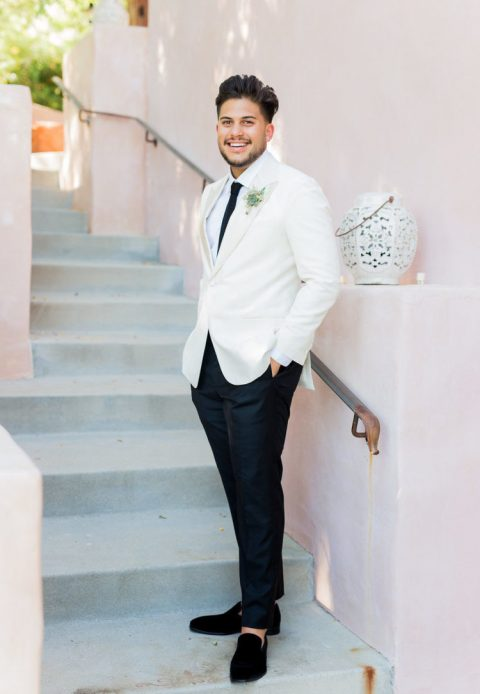 a dapper groom_s look with a white tux and black velvet loafers