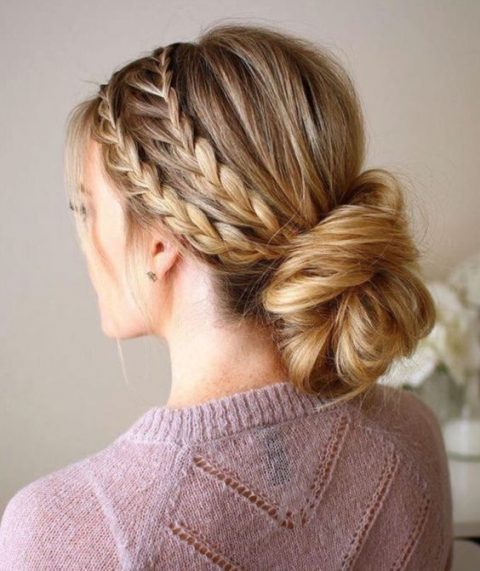 a double braided halo with a low twisted chignon
