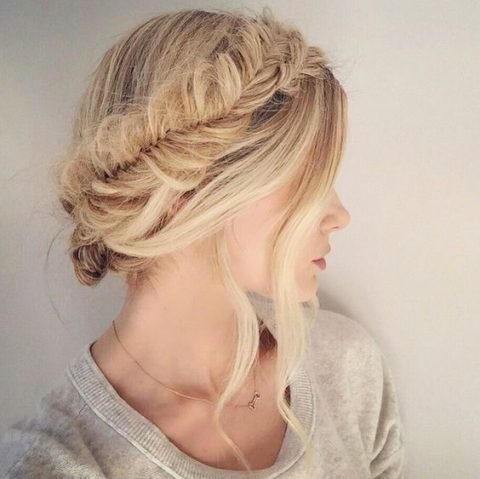 a fishtail braid halo updo with locks down