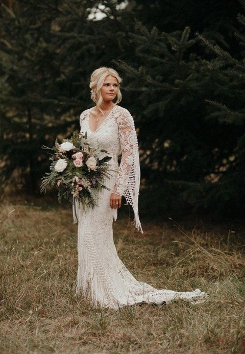 a fitting boho lace wedding gown with a V-neckline, a cape and a train for a truly boho bride