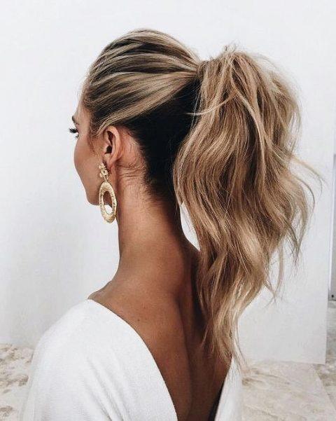 a high ponytail with a bump on top and textural hair