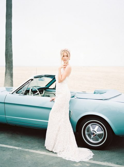 a lace halter neckline sheath wedding dress with a train is retro and modern at the same time