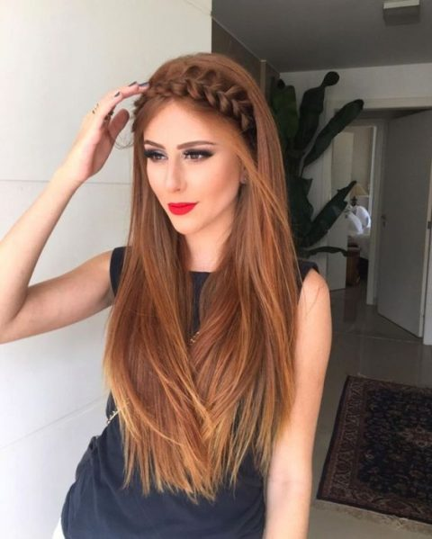 a large braid halo and straight hair for a bold and chic look