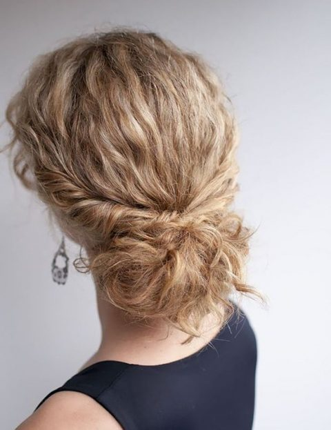 a low bun with curly hair and locks down