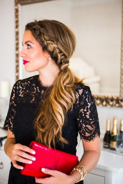 a low ponytail with a braid on one side and a wavy tail