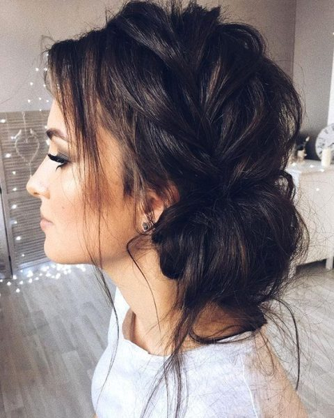 a messy side braided updo with locks down