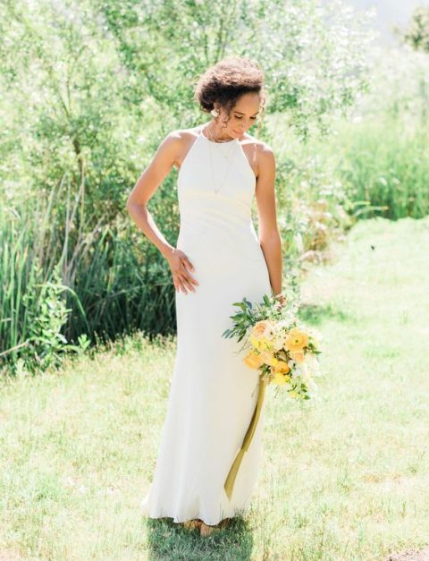 a minimalist halter neckline sheath wedding dress