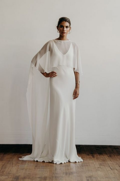 a modern slip dress paired with a trendy cape that goes down to the floor