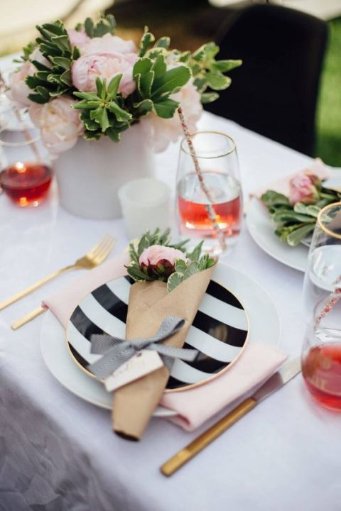a pretty tablescape with pink blooms and stripes plus gold cutlery for a cozy shower