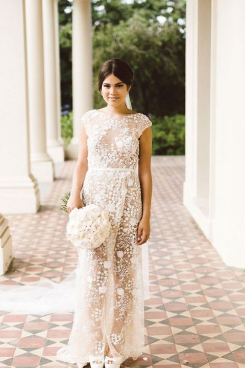 a sheath applique wedding dress with a wrap skirt, cap sleeves and a high neckline