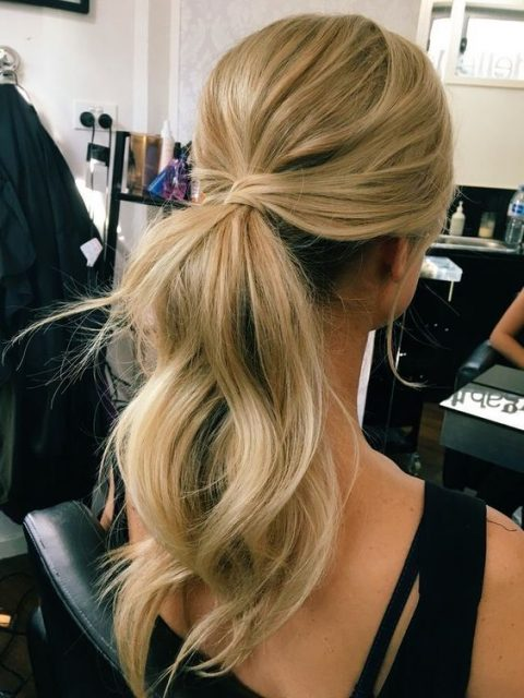 a simple and cute low ponytail with waves, locks down and a bump on top