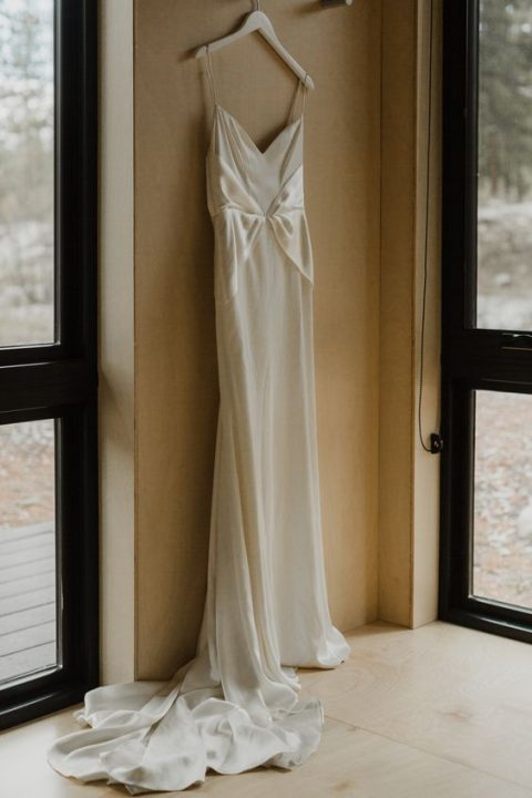 a stylish slip wedding dress with silk parts and a long train