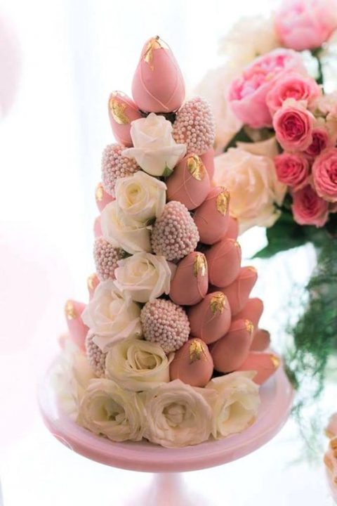 a tower of pink candied strawberries and white roses is a gorgeous idea for your bridal shower dessert table