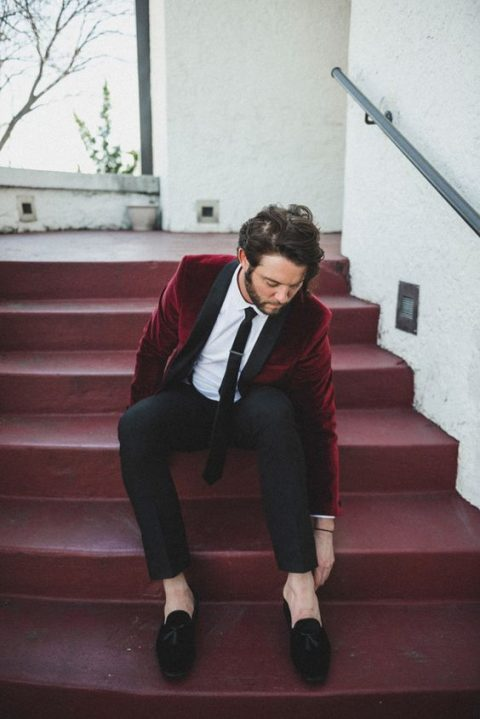 a trendy look with a burgundy tux with black lapels and black moccasins