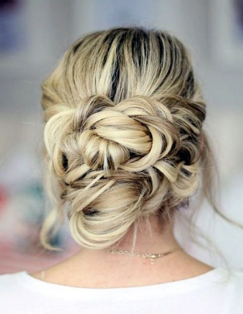 a twisted low updo with a bump and some locks down