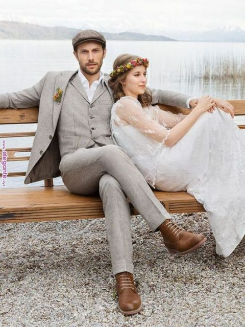 a vintage-inspired grey suit, a cap and brown boots