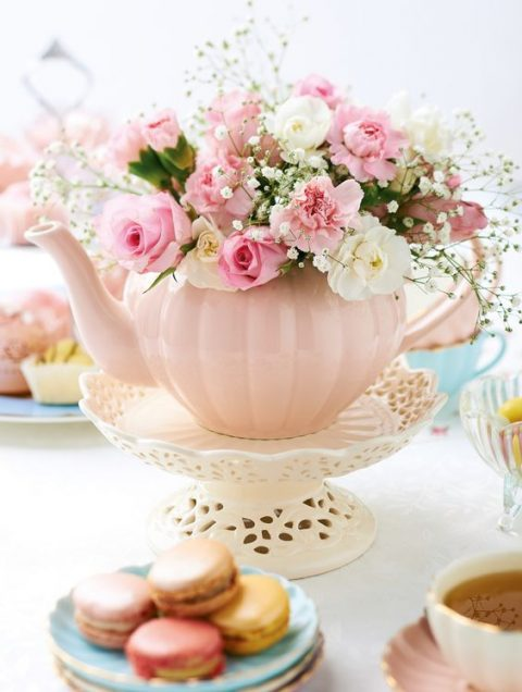 a vintage pink tea pot with fresh blooms on a stand will be a great party centerpiece