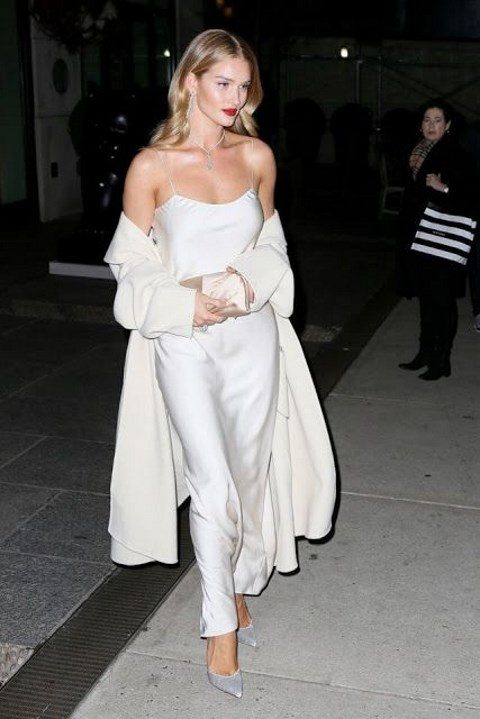 a white slip dress and a creamy coveurp plus silk shoes by Rosie Huntington-Whiteley