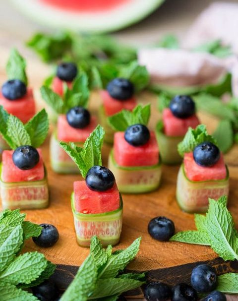 juicy watermelon cucumber vegan appetizers with mint and blueberries on top for a summer wedding