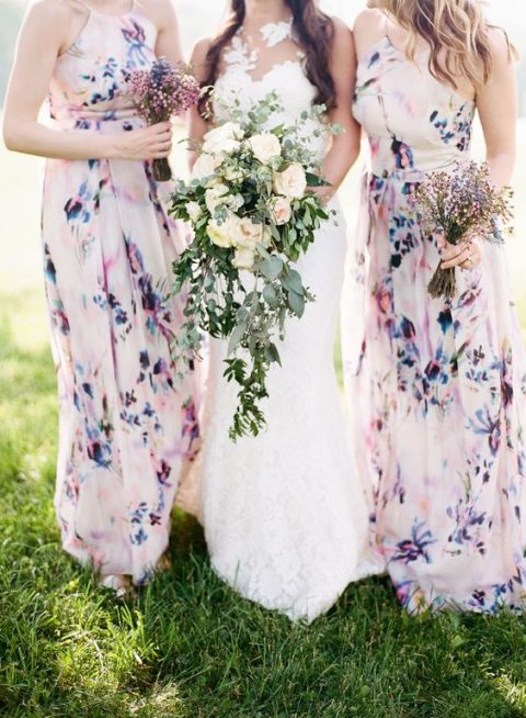mismatched blush and purple watercolor floral bridesmaids_ dresses look very spring-like