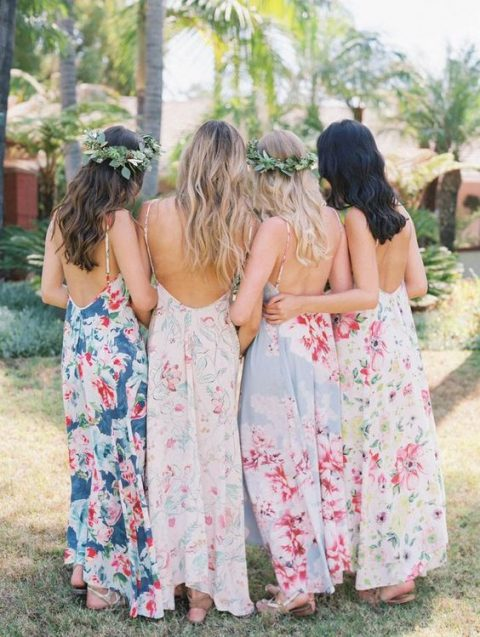 mismatched spaghetti strap dresses with open backs in various pastel shades and with different floral prints