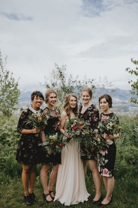 mismatching dark floral bridesmaids_ dresses of various lengths and looks