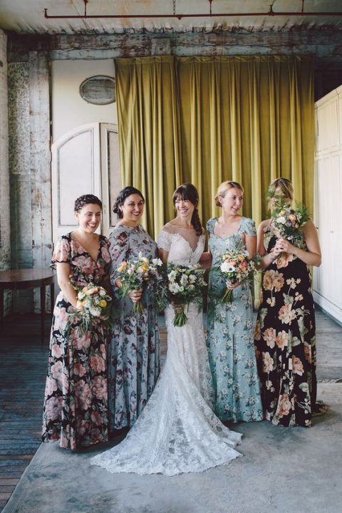 mismatching floral maxi bridesmaid dresses in various colors