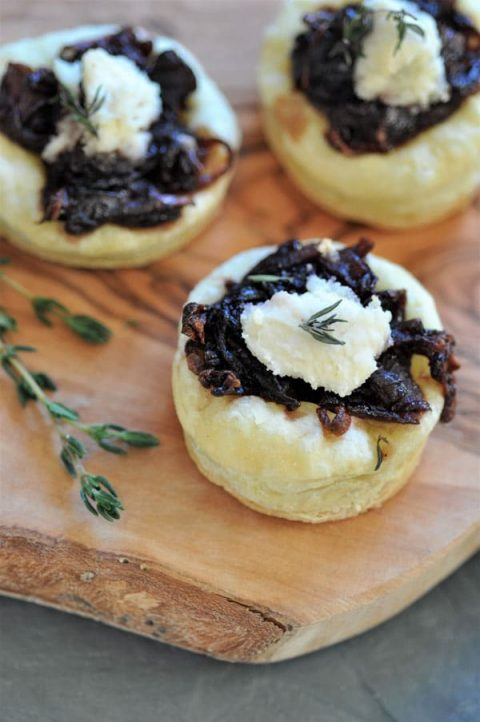 onion confit tartlets are a savory wine infused appetizer with a dollop of vegan ricotta and fresh thyme