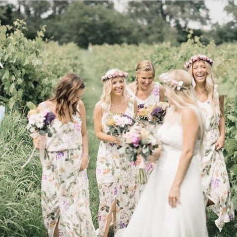 pastel floral bridesmaid dresses with thick straps and cuts plus front slit