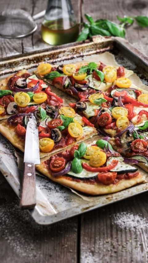 vegan pizza with various tomatoes, eggplants, peppers