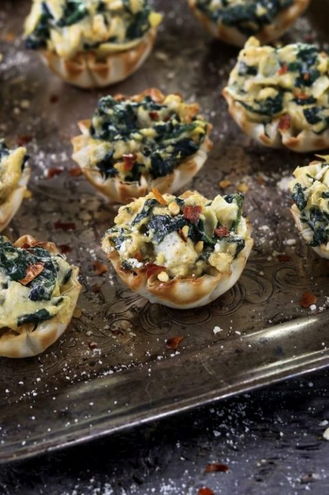 vegan spinach artichoke cups are a crowd favorite tucked inside a crispy and flaky shell