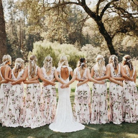 wide strap blush gowns with floral prints, open backs and floral crowns