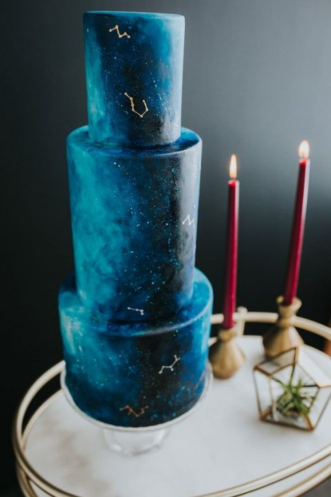 a beautiful and large blue celestial wedding cake with minimal decor