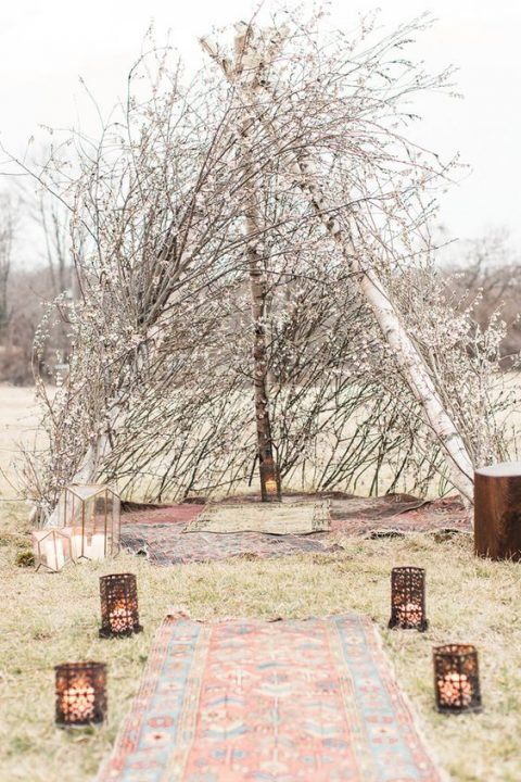 a boho teepee altar of willow and cherry blossom is ideal for a spring boho wedding