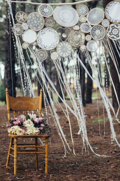 a crochet dreamcatcher wedding backdrop with ribbons